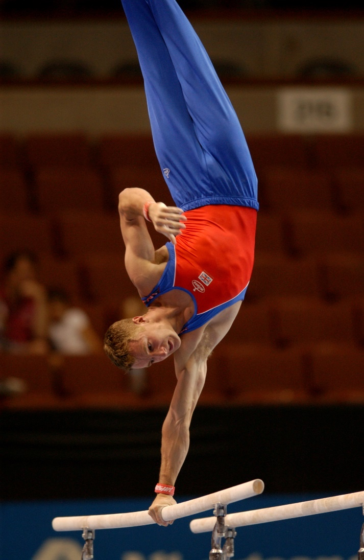 David Eaton competing on Parallel Bars at the World Championships in 2003