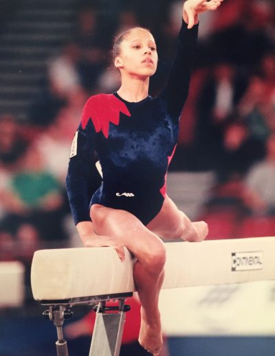 Zita Lusack gymnast competing on beam