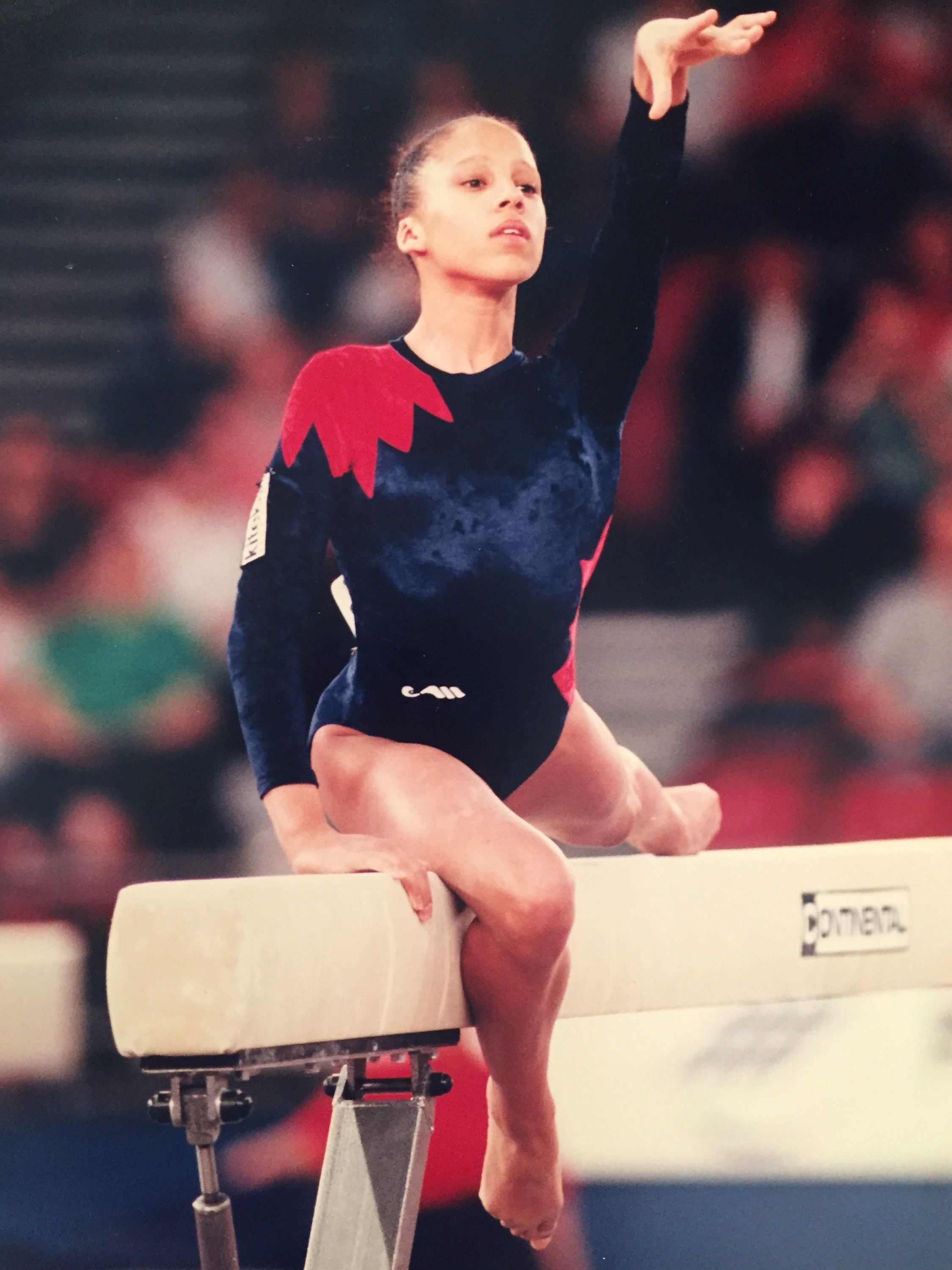 Zita Lusack gymnast performing on beam