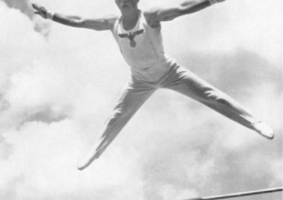 A German gymnast dismounting the high bar
