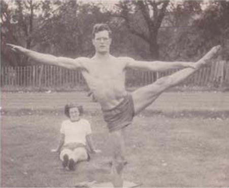 George Weedon, lacking suitable local facilities, built his own high bar from an iron curtain rail wedged between his garden wall and a tree. Seen here training in Battersea Park, London.