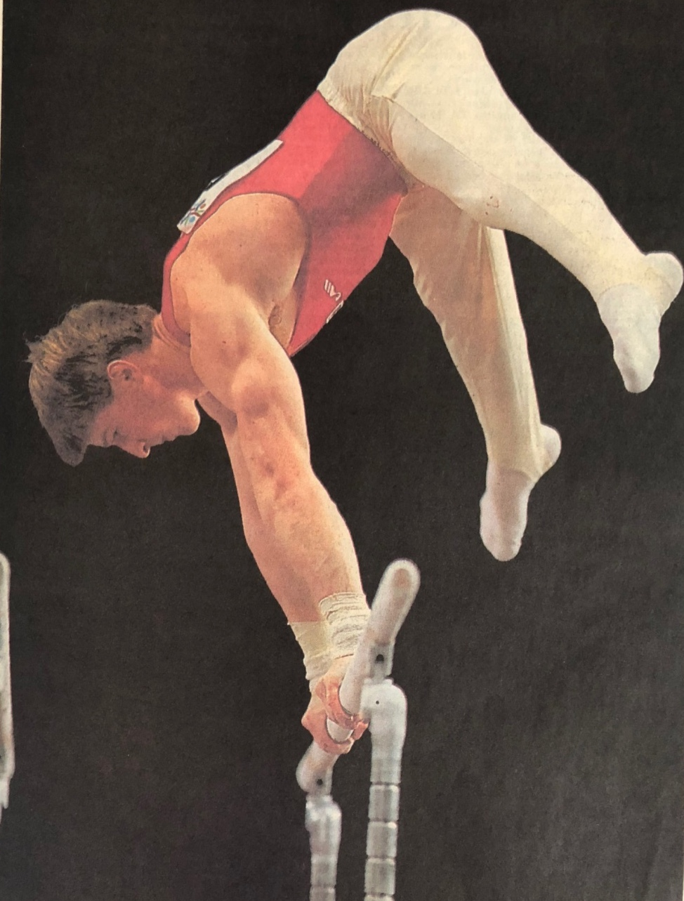 Paul Bowler competing on Parallel Bars