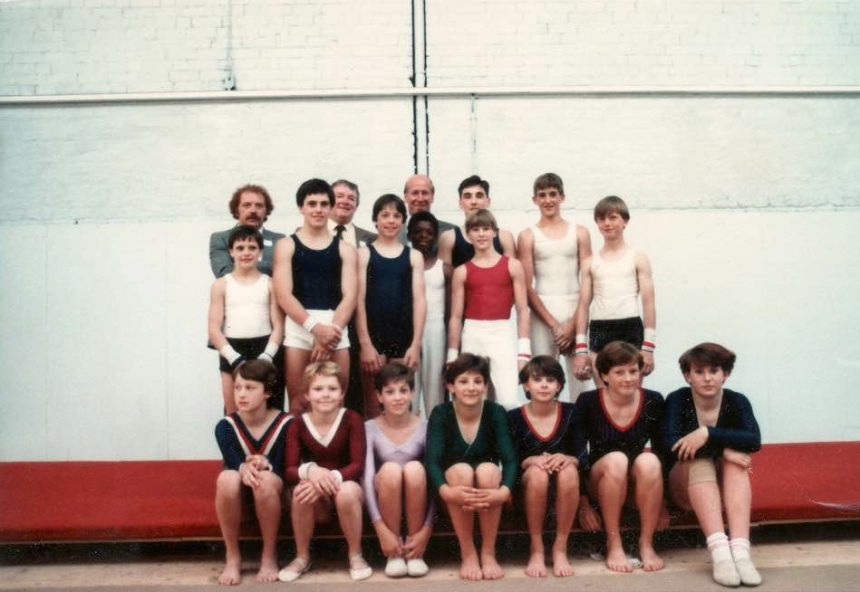 Paul Bowler in red at the the opening of the Gorton Gym. Paul Blakebrough by Paul's left shoulder. Also Colin Leigh is back row left and Sir Bobby Charlton centre back. Marvin Campbell is in front of Sir Bobby and next to Paul.